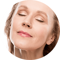 older woman with eyes closed – liposuction knoxville