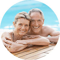 older couple by in pool – Plastic Surgeon Knoxville TN